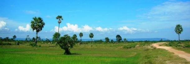 Phnom Kulen mountain range appears as a long, continuous silhouette in the background.
