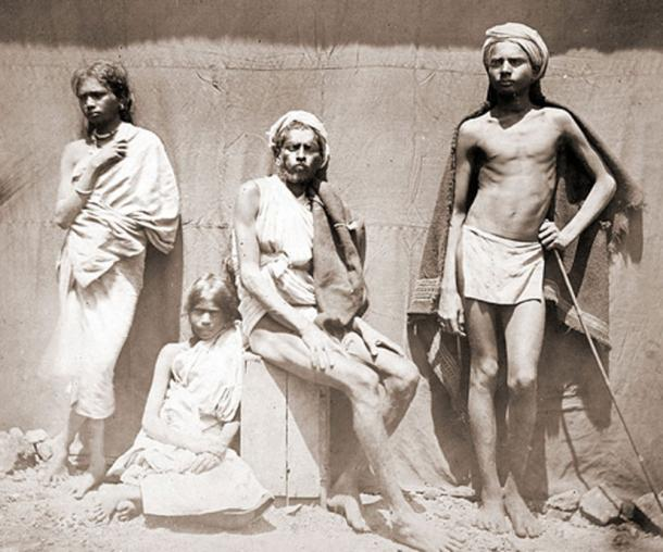 Photograph of two men and two women of the Malaiyali tribe in the Shevaroy Hills in Tamil Nadu - 1860s. (