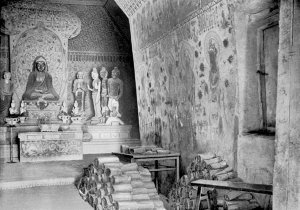 Picture of Cave 16, by Aurel Stein in 1907, with manuscripts piled up beside the entrance to Cave 17, the Library Cave.