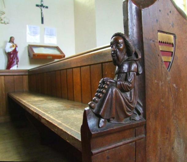 Picture from 2016 of one of the ornate pews of St Mary the Virgin Church in Wimbotsham. One of the wooden figures carved by James Rattee in 1853. Picture: Simon Knott
