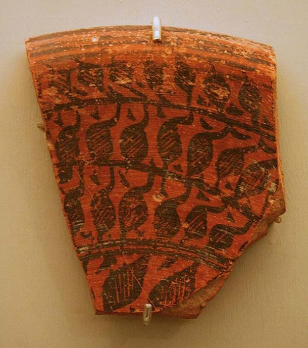 Piece of red pottery from IVC. Harappa. Fragment of large vessel.