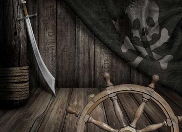 Pirates ship steering wheel with old jolly roger flag and saber (Andrey Kuzmin / Fotolia)