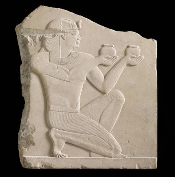 Plaque depicting a king offering wine (305–30 BCE), Egypt, possibly Ptolemaic dynasty, soft limestone