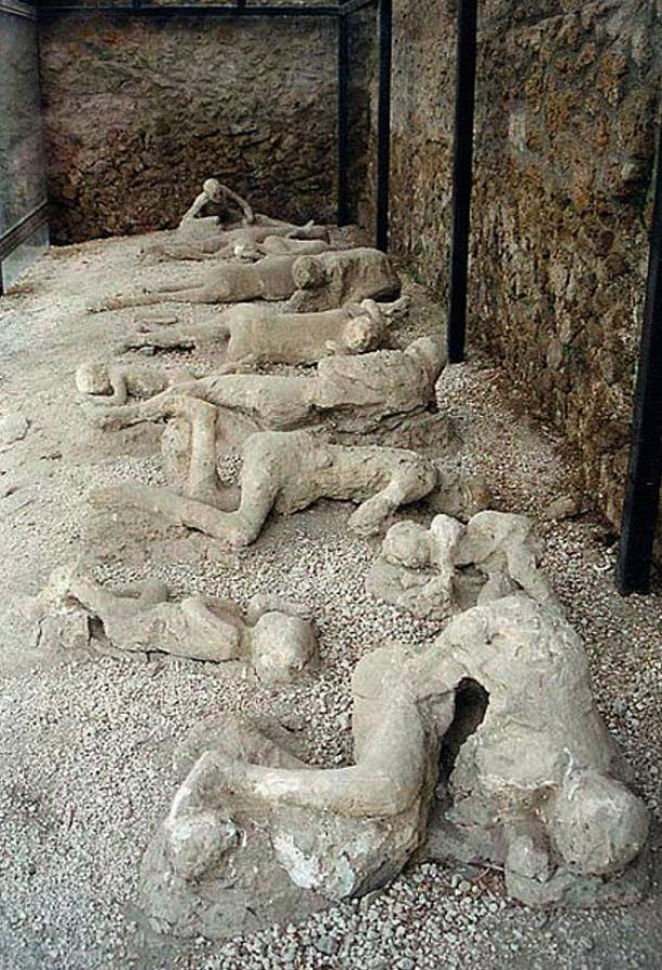"Plaster castings of the corpses of a group of human victims of the 79 AD eruption of the Vesuvius, found in the so-called ""Garden of the fugitives"" in Pompeii."