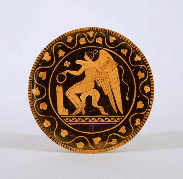 A Red-Figure Plate with Eros as a youth making an offering.