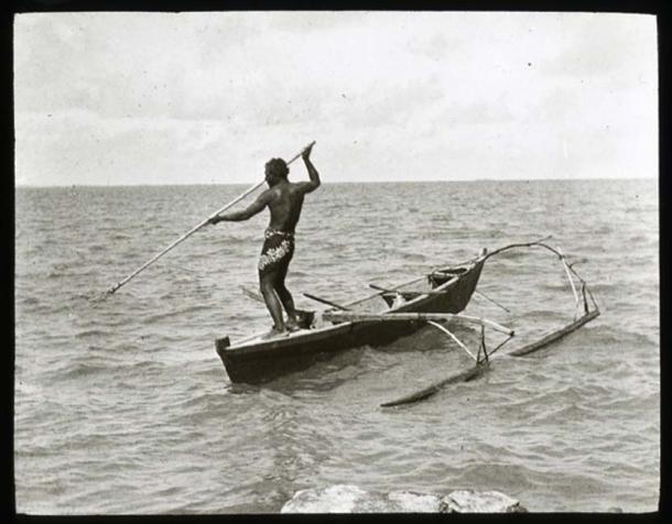 Polynesian outrigger canoe at sea (Public Domain)