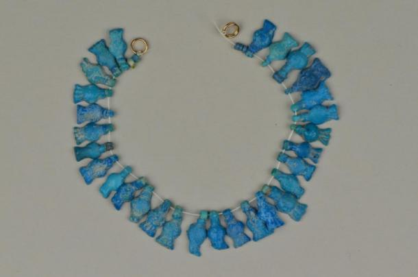 Pomegranate necklace from Amarna, made of blue faience ceramic. (Courtesy of National Museums Liverpool, World Museum)