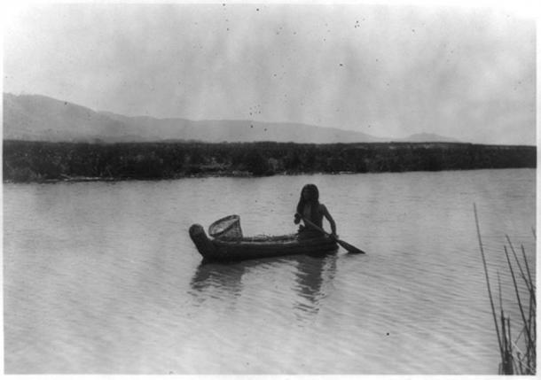 A Pomo Indian in a tule boat, circa 1924.
