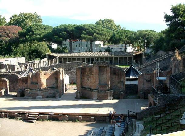 Pompeii was a flourishing city entombed in volcanic ash. Many people are believed to have escaped the eruption of Mount Vesuvius, but some people and many buildings, including this grand theater, were preserved in ash.