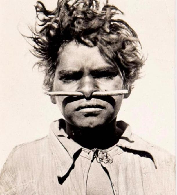 Portrait of an aboriginal boy with a nose piercing from the early 20th Century Image via Webb's.