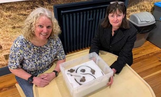 Posing with the impressive Viking hoard is Kath Giles, left, who found the hoard, and Allison Fox, curator for archaeology at Manx National Heritage. (Manx National Heritage Museum)