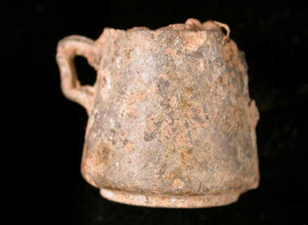 Post-medieval miniature tankard: Cast pewter 'toy' loving cup or wassail bowl with casting seams below the handles and across the base of cup. (The Portable Antiquities Scheme/ The Trustees of the British Museum)