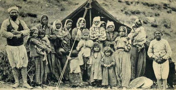 Postcard of group of Romani people in front of their tent in Smyrne. (Public Domain)