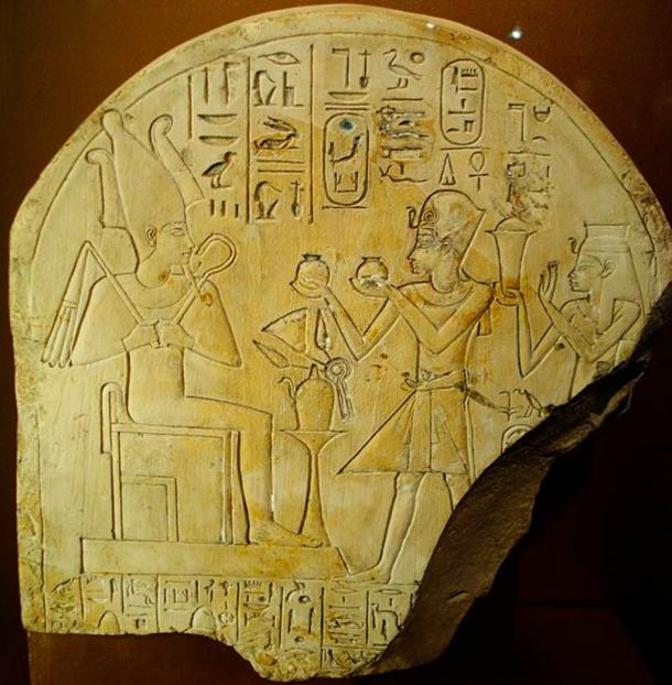 Posthumous stele of Amenhotep I and Ahmose-Nofretary making an offering to Osiris. Limestone. New Kingdom, Dynasty XVIII, reign of Amenhotep III, c. 1390-1352 BC. Probably from Thebes