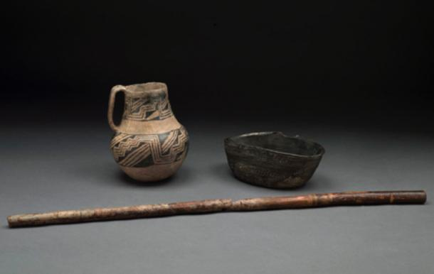 Pottery and wooden flute found in Room 33 of Pueblo Bonito (Chaco Canyon, New Mexico, U.S.A.).