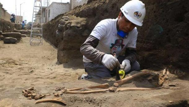 Excavating one of the Pre-Inca tombs