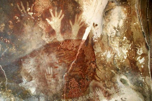 Prehistoric cave painting showing hands at Petta-kere, South Sulawesi.