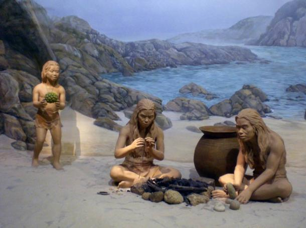 Prehistoric child holds a toy. Museum of History, Hong Kong