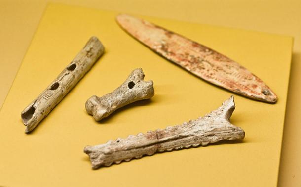 Prehistoric instruments from France. The bullroarer (upper right) is made with reindeer antler and was found in Lalinde, Dordogne.