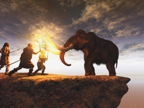 Prehistoric men hunting a young mammoth. (anibal / Adobe Stock)
