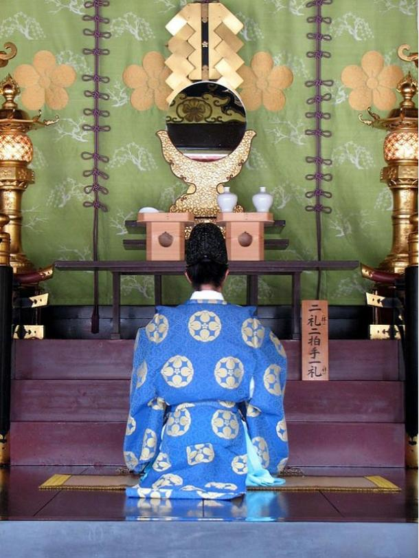 Priest in deep prayer at the Dazaifu Tenmagu Shrine in Fukuoka, Japan, 2007