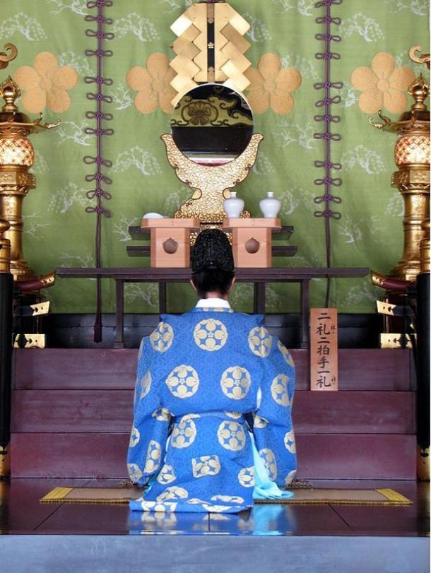 Priest in deep prayer at the Dazaifu Tenmagu Shrine in Fukuoka, Japan, 2007