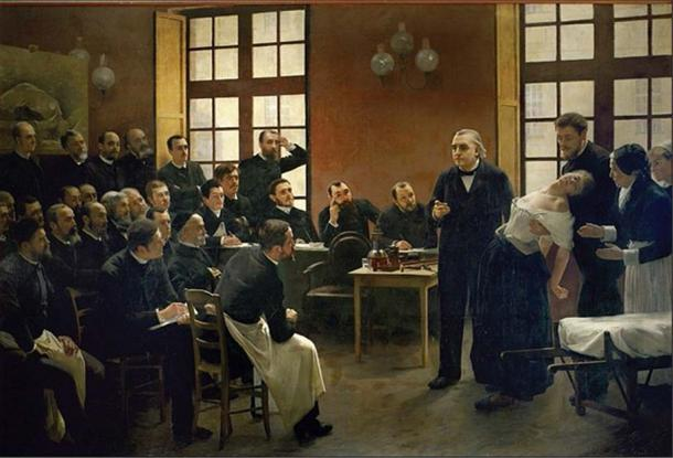 """Professor Jean-Martin Charcot teaching at the Salpêtrière in Paris, France: showing his students a woman (""""Blanche"""" (Marie) Wittman) in a trance or shock."""