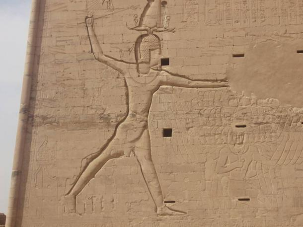 Ptolemy XII smashing his enemies with a royal mace. Relief from the first pylon in the temple at Edf.u