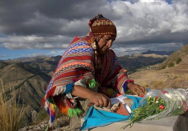A Quechuan shaman prepares an offering to Pachamama