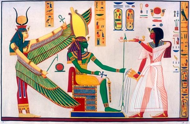 Rameses III censing and libating before Ptah-Sokar-Osiris, protected by winged Isis. Scene from tomb of Ramses III