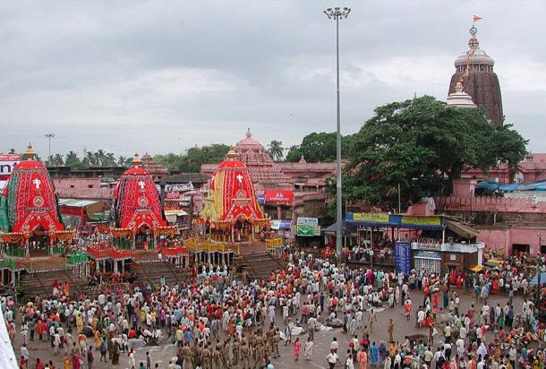 The Rath Yatra in Puri in modern times showing the three chariots of the deities with the Temple in the background.
