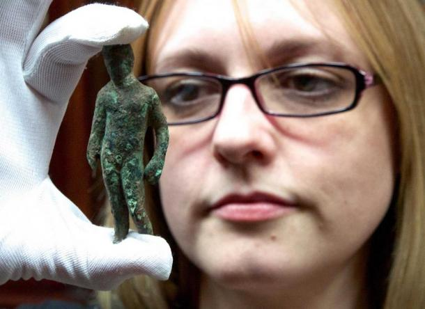 Rebecca Griffiths of York Museums Trust with the copper alloy figurine of Mercury.