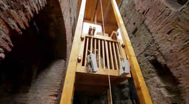 Reconstructed elevator once used to raise wild animals into the arena of the Colosseum. Screenshot from 'Colosseum: Roman Death Trap – Releasing the Wolf'.