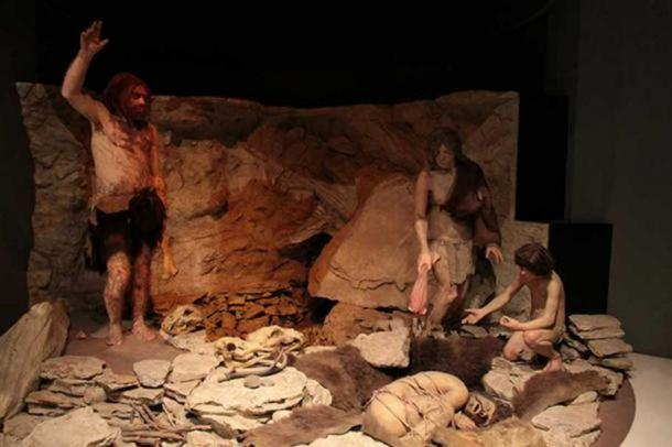 Reconstruction of Neanderthals burying an individual in a cave. National Museum of Natural History, Washington DC, USA.
