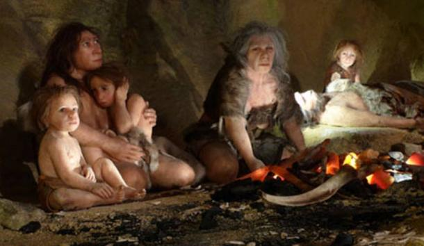 Reconstruction of a Neanderthal family taking shelter in a cave