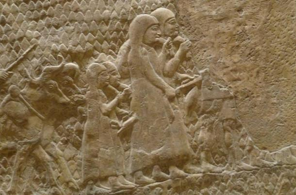 Relief from Sennacherib's palace in Nineveh celebrating the Assyrian destruction of the city of Lachish. This section depicts women and children, followed by a man driving oxen, fleeing from the besieged city.