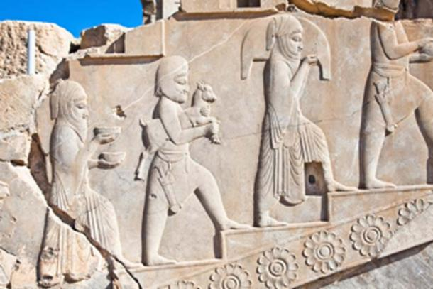 Relief decoration of displayed subjects on the ruins of the Apadana. (Aleksandar Todorovic / Adobe Stock)