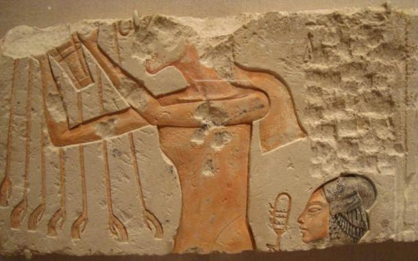 Relief depicting Akhenaten and His Daughter Offering to the Aten
