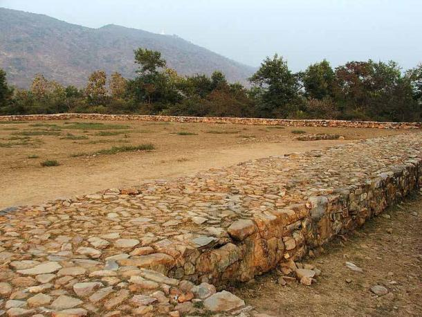 Remains of what has been identified as Bimbisara's Jail, at Rajgir, Bihar, India. This is suspected of being the place where Prince Ajatasatru jailed his father King Bimbisara and starved him to death. Some jail equipment was found at the site, and the Grijjakuta hill (Vulture Peak) can be seen from the site. (BPG/CC BY-SA 2.5)