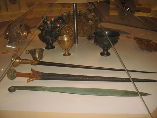Replicas of Mycenaean swords and cups.