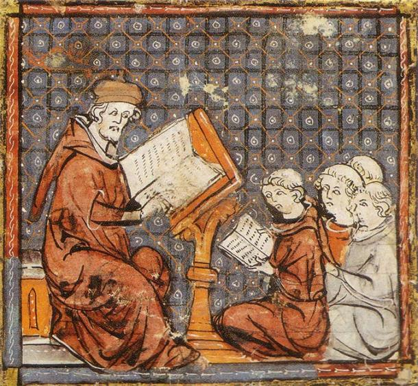 Representation of children studying philosophy with a monk in monastery during medieval times. (Public domain)