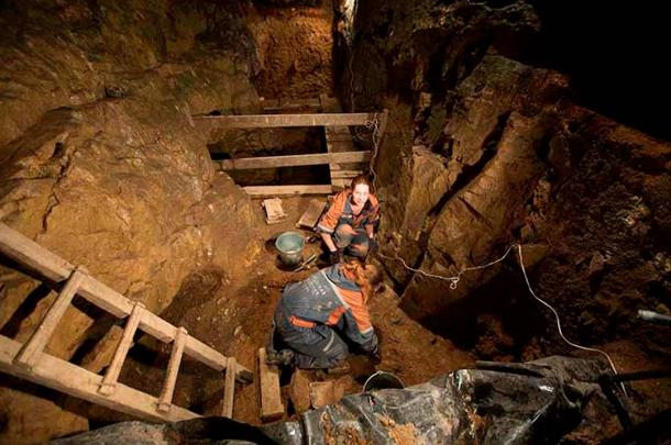 Researchers work inside the Denisova Cave