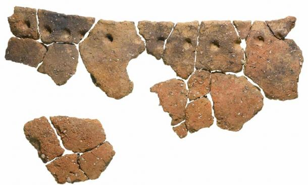 Residues found within the round-bottomed vessel suggest it was used to process meat stew. These fragments were used as part of the new dating technique. (MOLA)