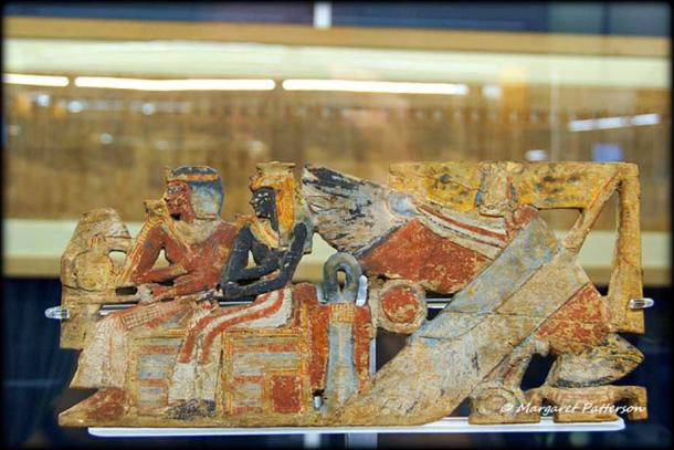 Richly colored fragments of a Sedan Chair show the deified Queen Ahmose-Nefertari seated alongside her deified son Amenhotep I. Museo Egizio, Turin, Italy.