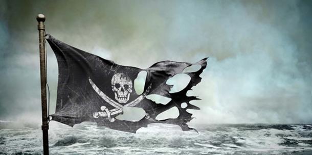 Ripped pirate flag. (adimas / Adobe)