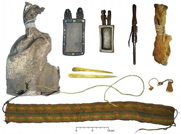 Ritual bundle with leather bag, carved wooden snuff tablets and snuff tube with human hair braids, pouch made of three fox snouts, camelid bone spatulas, colorful textile headband and wool and fiber strings. (Photos courtesy of Juan Albarracín-Jordán and José Capriles.)