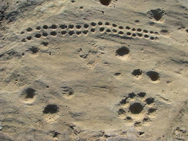 Rock art and dot carvings at Jebel Jassassiyeh (Qatar) dating to c. 4000 BC.