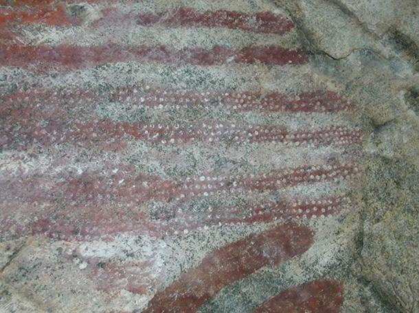 Rock art of red pigment (Photo by UNESCO)