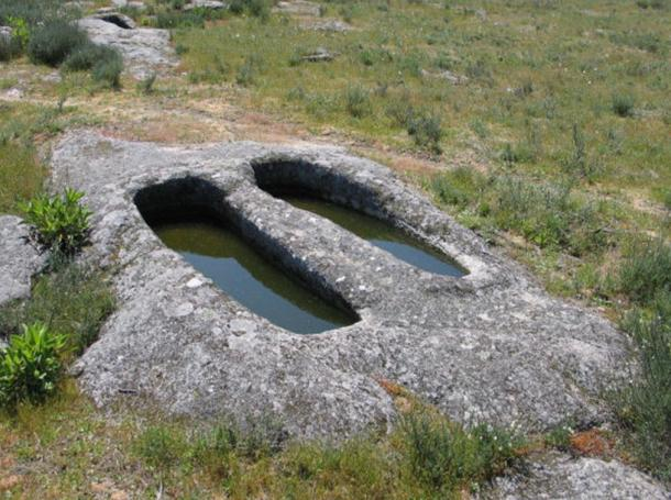 Rock-cut graves in Fornos de Algodres, Portugal, said to be the place where the Mouras knead bread