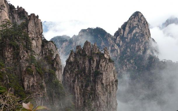 Rock formations and mountains at Huangshan, China. Visitors to the mountain may discern various real or mythical creatures in the rock formations.